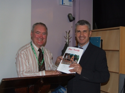 Johnny presents Trevor with a copy of the journal - PHOTO Pat Devlin