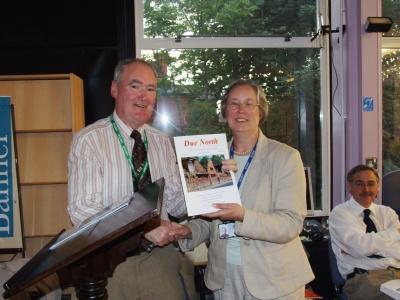 Johnny presents Valerie Adams, PRONI, with a copy - PHOTO Pat Devlin