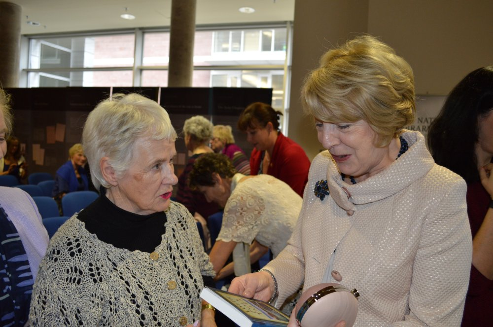 "Doreen McBride presents Sabia with a copy of her book <u>Louth Folk Tales"" width=""375″ height=""231″ border=""1″ hspace=""5″></td> </tr> <tr> <td><center><i>Group with President and Sabina after the event</i></center></td> <td><center><i>Doreen McBride presents Sabia with a copy of her book <u>Louth Folk Tales</u></i></center></td> </tr> </tbody> </table> <p>Thanks go to everyone who attended. We had a terrific turn out with 90 – 100 people attending from all over the country from as far afield as Waterford and Derry (Londonderry) representing both Hidden Gems & Forgotten People contributors and members from many history societies around the country.</p> <p> </p> <table width="